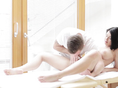 Sexy masseur excitingly fondles hot brunette's cunt