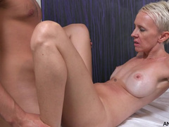 Skinny milf enjoys being fucked by strong masseur